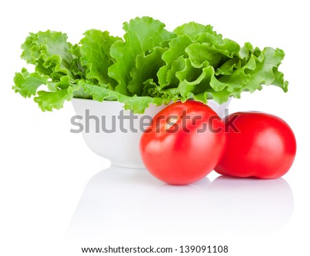 Bowl with fresh lettuce and two red tomatoes isolated on white background - stock photo