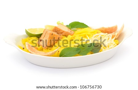 Bowl with fresh noodles and vegetable isolated on white