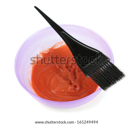 Bowl with hair dye and brush for hair coloring, isolated on white - stock photo