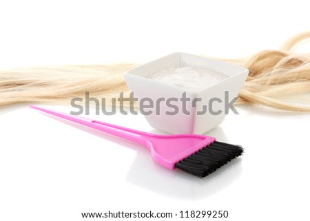 Bowl with hair dye and pink brush on white background close-up - stock photo