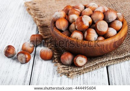 Bowl with hazelnuts on a old wooden table