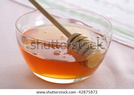 Bowl with honey and spoon, backlight