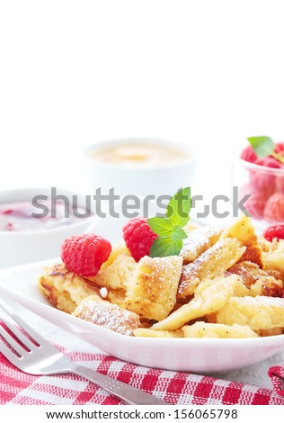 Bowl with Kaiserschmarrn, berries and fruit sauces. - stock photo