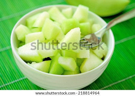 Bowl with melon salad on table - stock photo