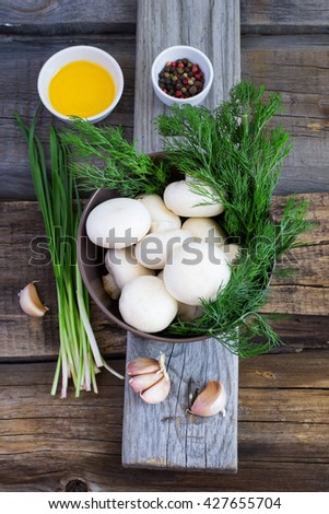 bowl with mushrooms, herbs and spices on an old background - stock photo