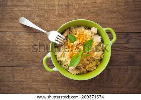 Bowl with pilaf on wooden background - stock photo