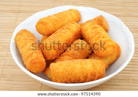 Bowl with potato croquettes