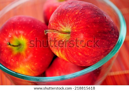 Bowl with red apple on background - stock photo