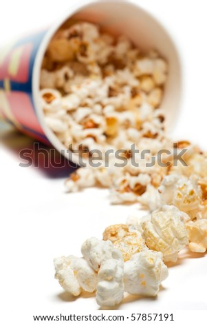 Bowl with spilled popcorn isolated on white