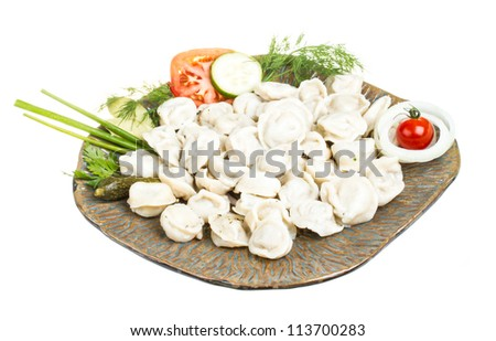 Bowl with traditional russian dish - pelmeni (dumplings)