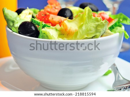 Bowl with vegetable salad on table