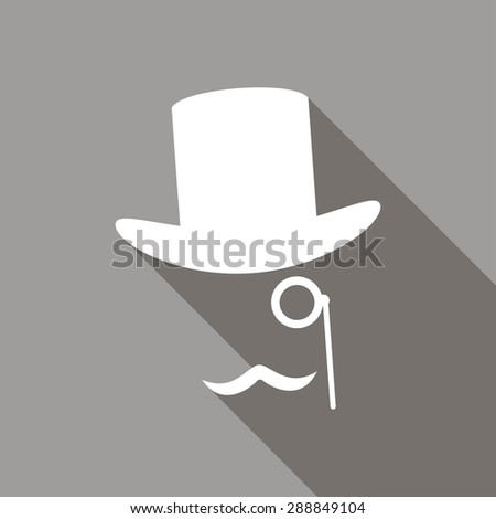 Bowler hat and moustache with a long shadow - stock photo