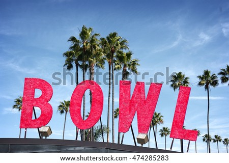 bowling alley sign with palm trees