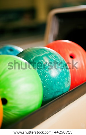 Bowling balls in a bowling alley ready to be used