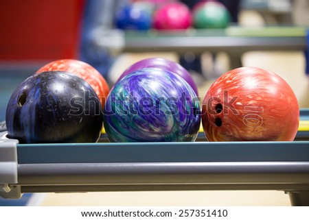 Bowling balls in stand - stock photo