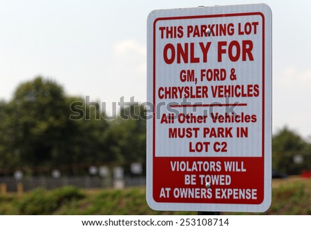 BOWLING GREEN, KY - AUGUST 2: A United Auto Workers parking sign located in Bowling Green, Kentucky on August 2, 2014. The UAW is an American labor union that represents workers in the US and Canada. - stock photo