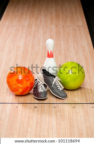 Bowling pins, balls and shoes - stock photo