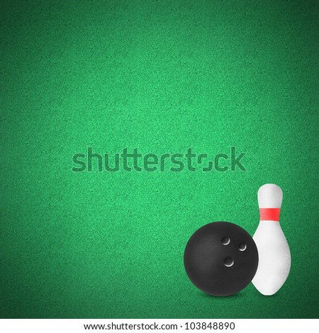 Bowling sport craft on green grass by cork board - stock photo