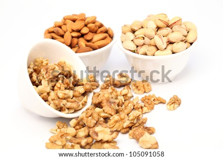 Bowls of Almond,pistachios and wall nuts - stock photo