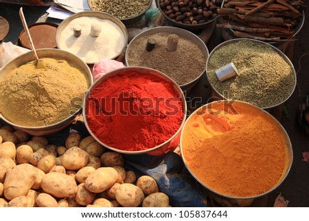 Bowls of cooking spices in Indian market Goa - stock photo