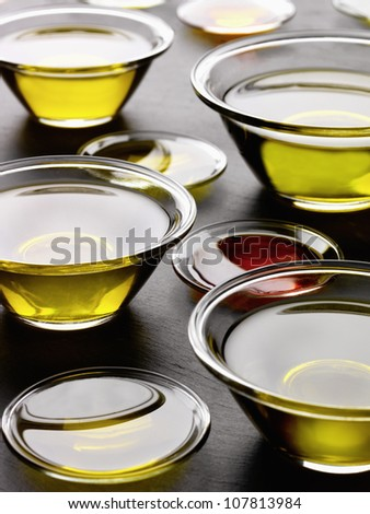 Bowls of oil - stock photo