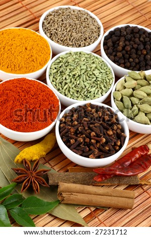 bowls of spices on mat background - stock photo