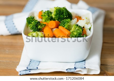 Bowls of variety vegetables on table