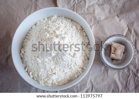 Bowls with flour and yeast.