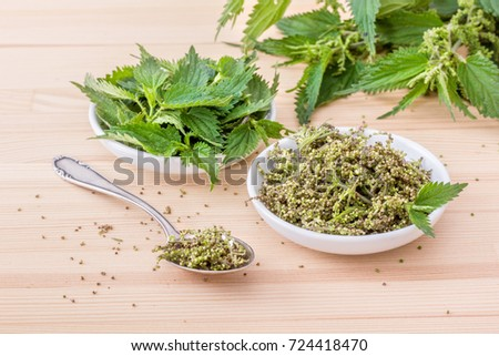 Bowls with fresh Nettle seeds and nettle leaves / fresh Nettle seeds / nettle