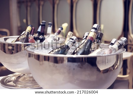 Bowls with iced champagne, toned image - stock photo