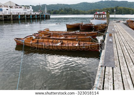 BOWNESS ON WINDERMERE, LAKE DISTRICT/ENGLAND - AUGUST 20 : Rowing Boats moored at Bowness on Windermere in the Lake District England on August 20, 2015