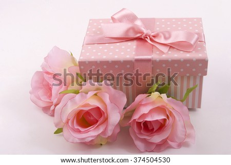 Box and roses - stock photo