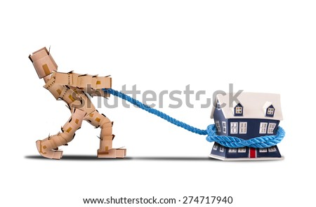 Box character pulling a house with a rope on a white background - stock photo