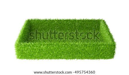 Box covered a green grass. 3d image isolated on a white background.