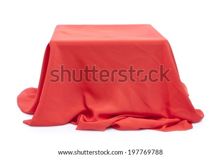 Box covered with a red cloth  - stock photo