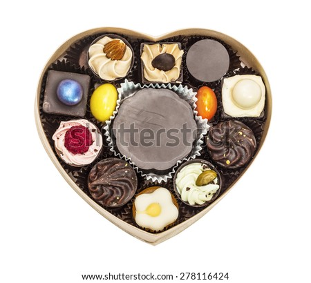 Box filled from collection chocolate candies Valentine's Day, isolated on white background - stock photo