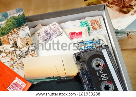 Box filled with memories. Box filled with letters and photos. Photos where taken in Paris, and on the beach of the Mediterranean Sea. (Near Agde, France)  - stock photo