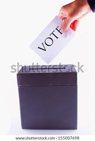 box for vote, with male hand posting vote - stock photo