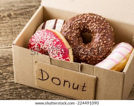 Box full of donuts ready to eat - stock photo