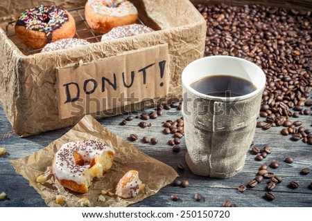 Box full of donuts with coffee - stock photo