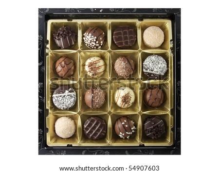 Box of assorted chocolates on white background - stock photo