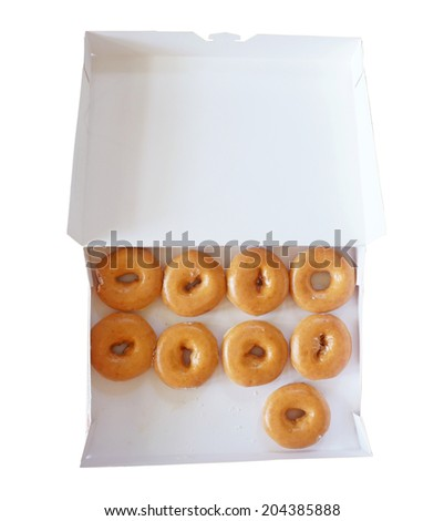box of fresh donuts isolated on white - stock photo