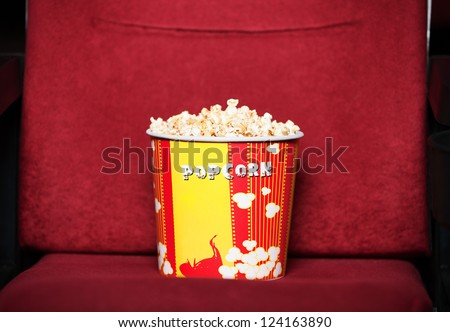 Box of popcorn on cinema chair
