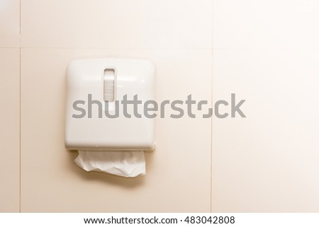 Box of tissues on wall in toilet