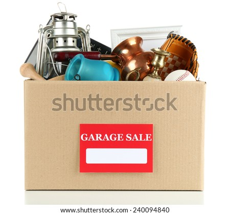Box of unwanted stuff ready for a garage sale, isolated on white - stock photo