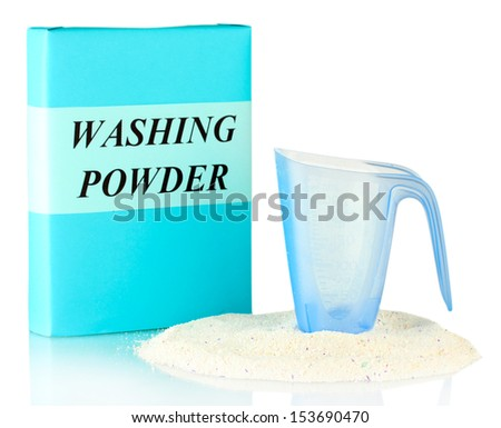 Box of washing powder with blue measuring cup, isolated on white - stock photo