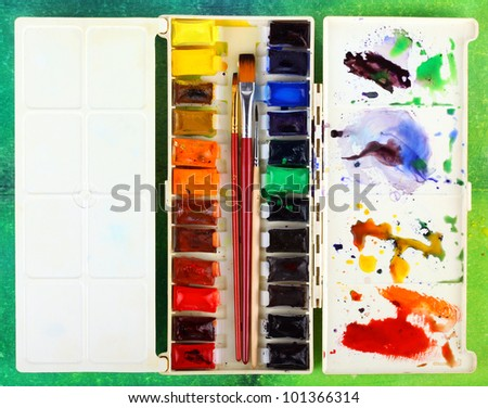Box of watercolors with three brushes - stock photo