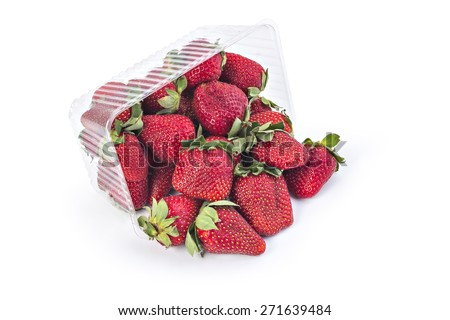 Box or punnet and spilled fresh red ripe organic strawberries isolated on white background - stock photo
