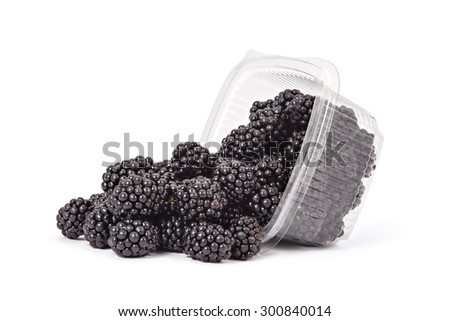 Box or punnet and spilled fresh ripe organic blackberries on a white background - stock photo