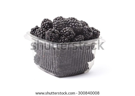 Box or punnet of fresh ripe organic blackberries on a white background - stock photo